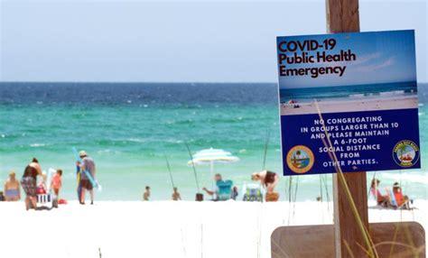 covid florida beach sign coronavirus cases states cidrap