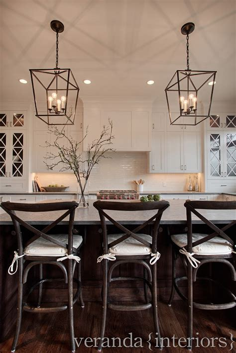 kitchen pendant lighting over island white kitchen cross mullions on glass windows dark