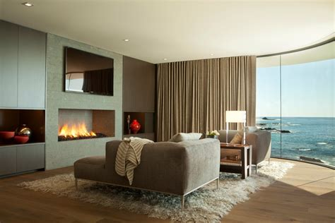 modern fireplace rug sofa curved window beach house  laguna beach california fresh palace