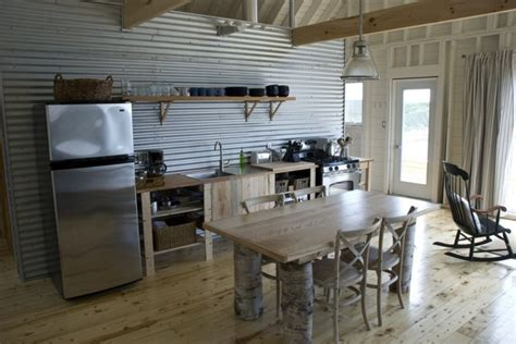 cottage kitchen backsplash corrugated metal wall and exposed framing of small cottage 2637