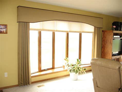 window fashions an eyebrow shaped cornice board with