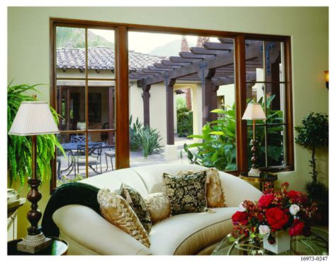 spanish colonial home style mediterranean living room minneapolis  andersen windows