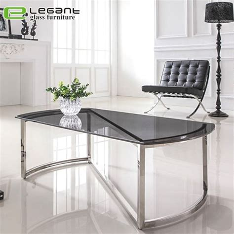 The tempered glass used offers an elegant view of the collectibles or display. China Modern Round Clear Tempered Glass Coffee Table with Stainless Steel Frame Base - China ...