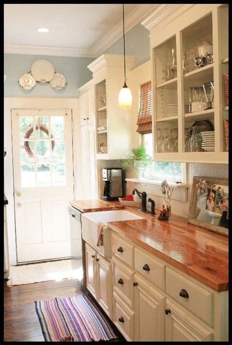 kitchens with cabinets and countertops white cabinets butcher block countertops and pretty blue