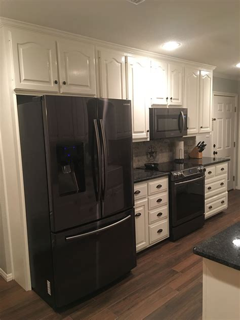 black stainless steel appliances steel gray counter tops benjamin moore simply white cabinets