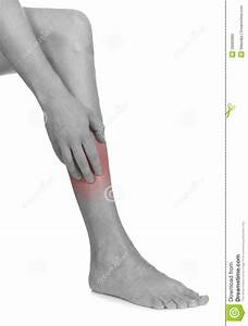 Women Scratch Itchy Leg With Hand  Stock Photo