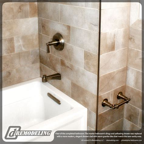 white tub with rubbed bronze fixtures traditional