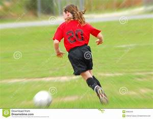 Young Soccer Player Chasing Ball Stock Images - Image: 9585244