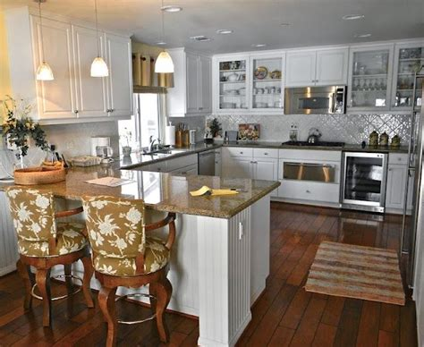 kitchen with island and peninsula island vs peninsula which kitchen layout serves you best cabinets in kitchen and islands