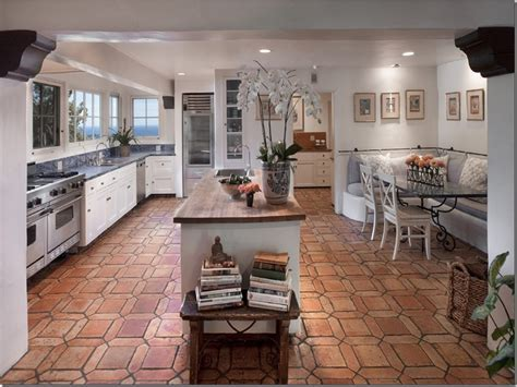 White cabinets, gray and wood counters, and terracotta