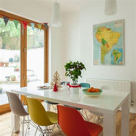 Dining room with multi-coloured chairs | Dining room ...