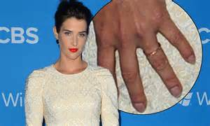 Cobie Smulders shows off her wedding ring in bridal white ...