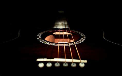 blue  black acoustic guitar  background