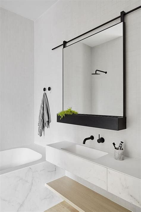 16 marble bathrooms with black fixtures