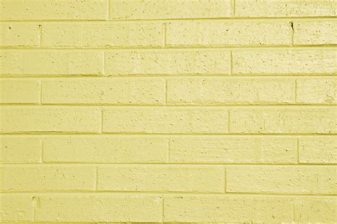 light yellow brick wall yellow painted brick wall texture picture free