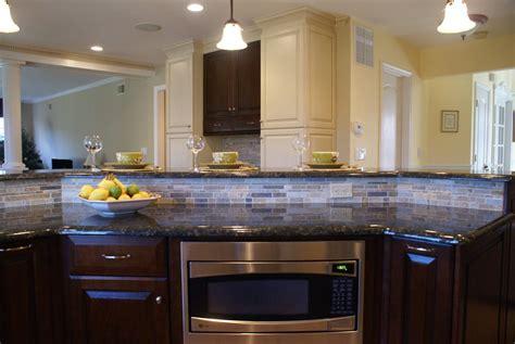 kitchen island power 2 tiered kitchen island power grommets add convenience