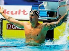 Dressel stands tall with record medal haul