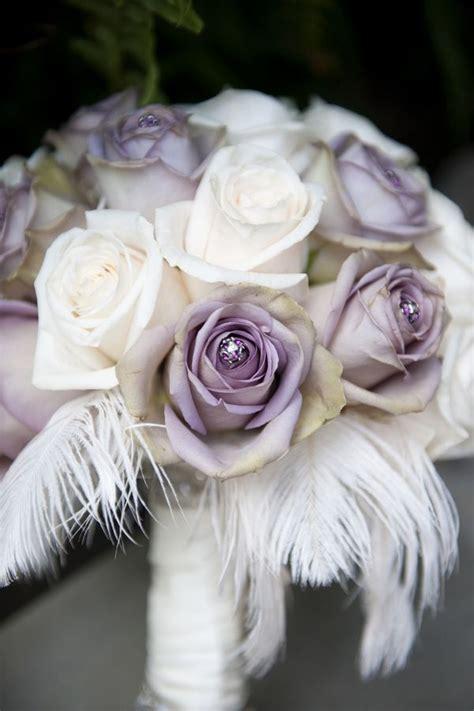 purple  white rose wedding bouquet  feathers