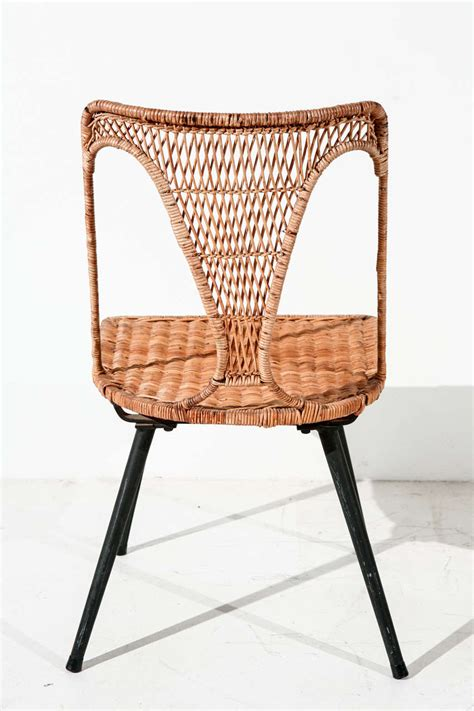 wicker and iron table and set of six dining chairs at 1stdibs