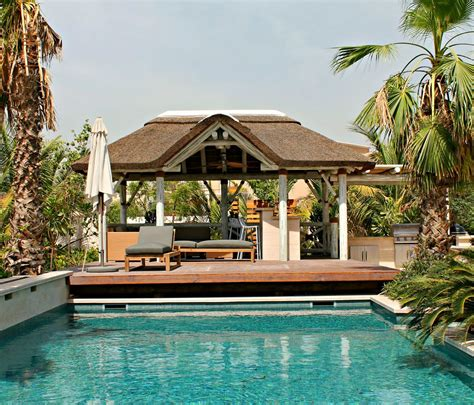 Thatched Roof House With Outdoor Entertaining Spaces by Outdoor Living Space With A Whitewash Thatched Gazebo