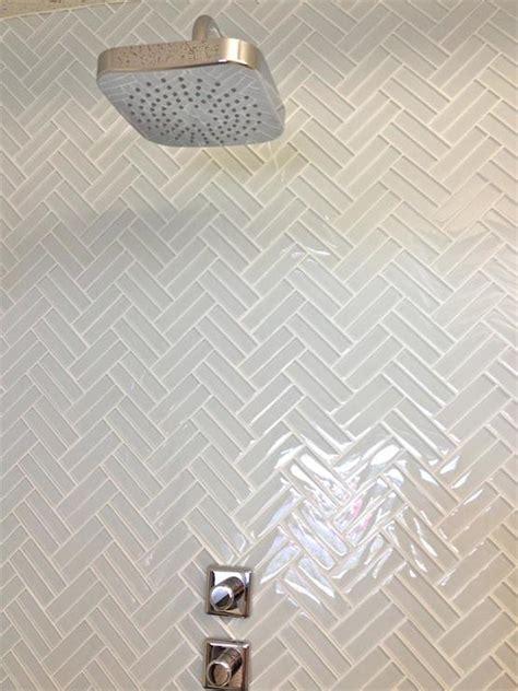 herringbone shower tiles transitional bathroom