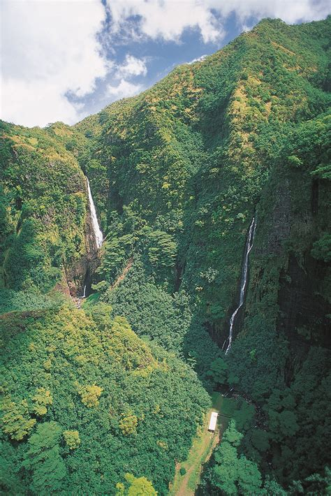Waterfalls In The Marquesas Mountains In The Islands Of