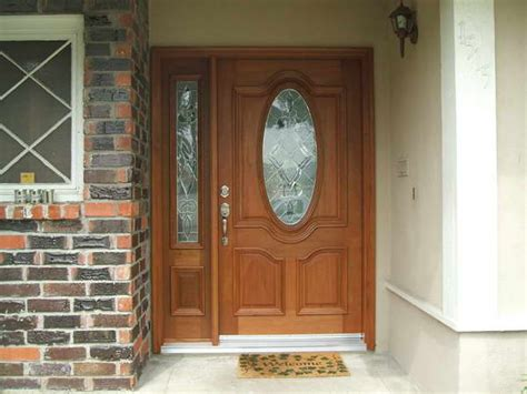wood entry doors with sidelights of oval glass front entry
