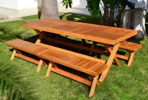 long outdoor folding picnic table bench with separate folding benches on green grass garden ideas
