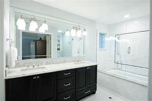 Traditional Master Bathroom With Dark Cabinets And White