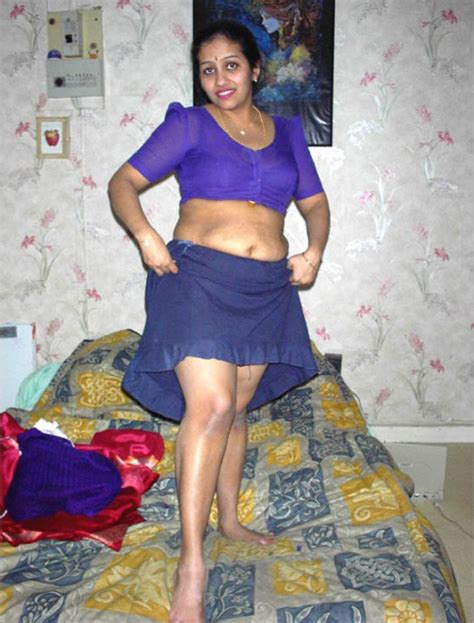 Indian Aunty Lifting Saree Cumception