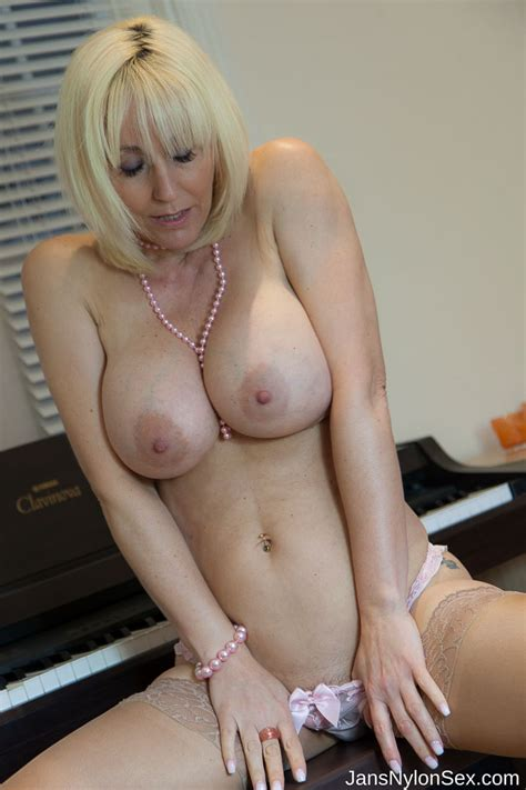 Hot Milf Jan Burton Flashes Her Pussy In Holdup Stockings