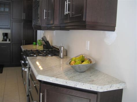 Charming White Granite Countertops For Elegant Kitchen
