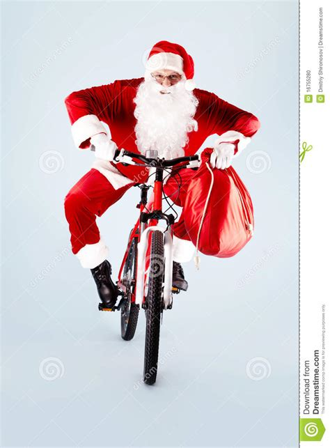 santa on bicycle stock photo image of isolated christmas