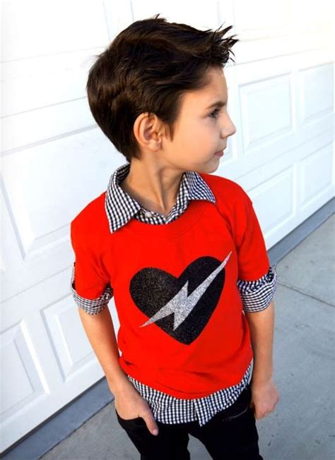 Picture Of dark denim a gingham shirt and a red sweater with a glitter heart