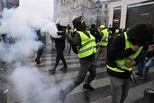 Paris on lockdown with tear gas and water cannons fired at ...