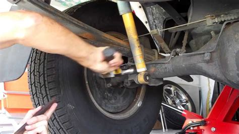 tacoma rear shock replacement youtube