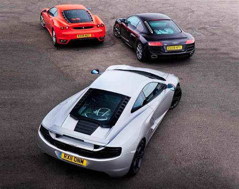 One of the most recognisable features of its pininfarina design are the long side strakes. Audi R8 V10 Type 42 vs. McLaren MP4-12C and Ferrari F430 - Drive