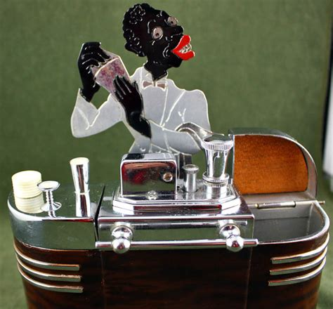 impressive figural deco ronson touch the dandy can deco perfection