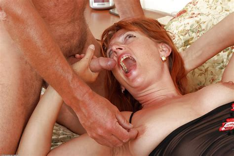 older redhead libby and her husband having sex in 69 position