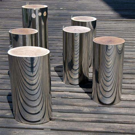 mirrored tree trunks malafor trunks serve  stools
