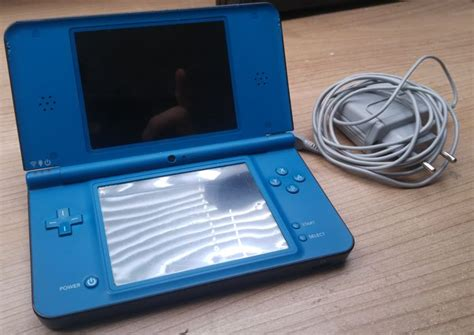 Nintendo Dsi Xl Blue With Charger. Incl 16 Ds Games