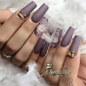 Matte grey coffin nails with flowers and gold ribbon color is
