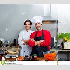 Chef Couple Man And Woman Posing In Kitchen Stock Image