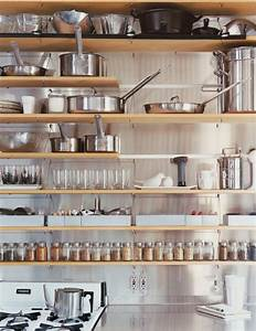 Tips for stylishly stocking that open kitchen shelving for Kitchen storage shelves ideas