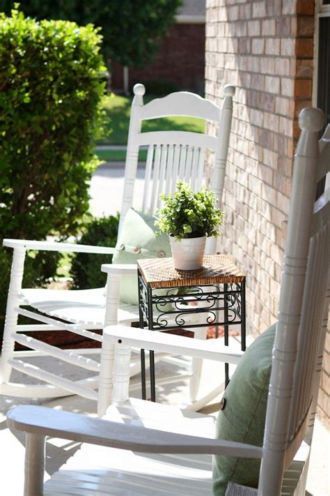 front porch with white rocking chairs