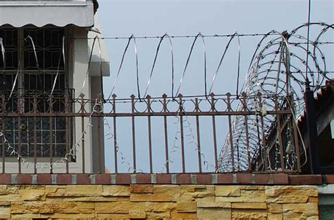 security fence for home picture of a house with a metal security fence and bob wire fencing on top