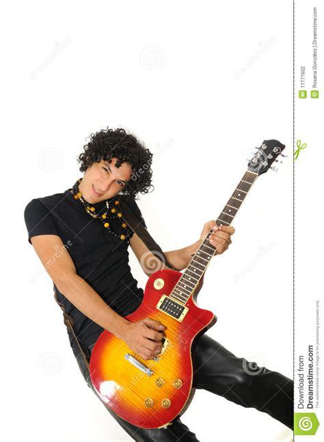 trendy hispanic guy playing electric guitar stock