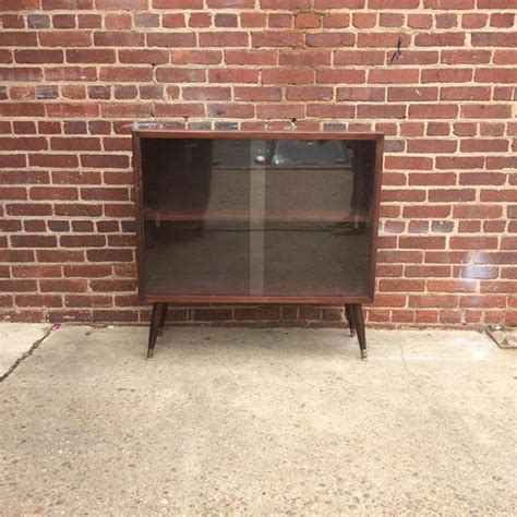 small mid century modern glass front storage cabinet