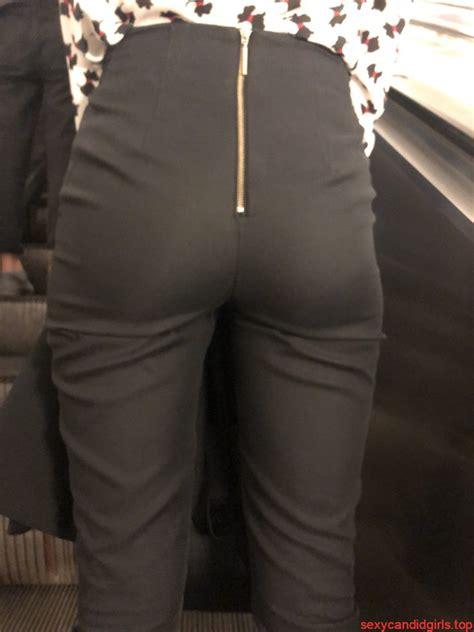 girl  black pants subway creepshot   escalator