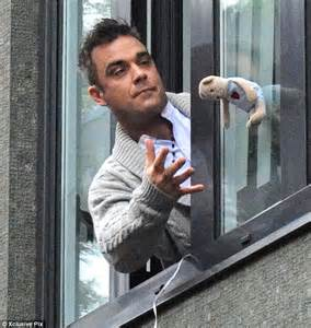Baby Shower Dad Gifts by Robbie Williams Catches A Teddy Bear As Fans Throw